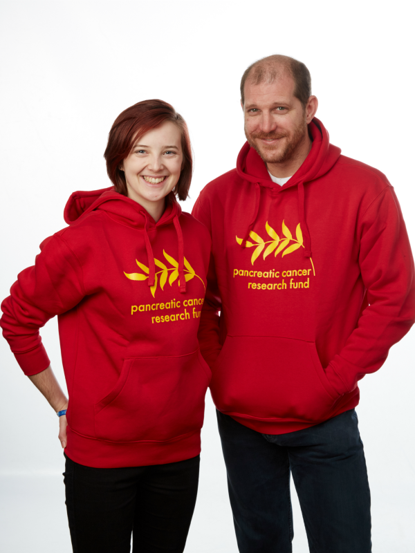 Female and male models wearing PCRF hoodie sweatshirt