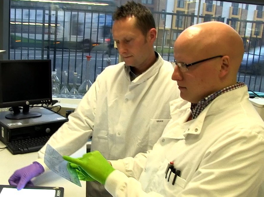 Dr Jason Bruce and co-researcher Dr Andrew James in the lab